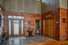 Entryway Combo of Custom Barnwood and Hand Hewn Log Siding